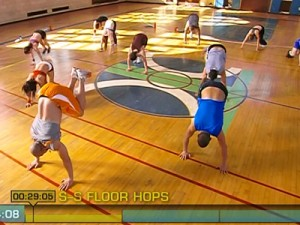 Insanity Max Cardio Conditioning-side to side floor hops